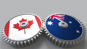 Flaggen von Kanada und von Australien auf Zahngetrieben Begriffs-Wiedergabe 3D der internationalen Zusammenarbeit stock abbildung