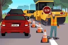 Flagger die bij de wegenbouw werken Stock Afbeelding