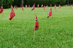 flaggor arbeta i trädgården norrman arkivbild