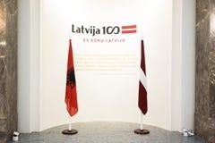 Flaggor av Albanien och Lettland Arkivbild