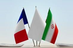 Flaggor av Frankrike och Iran royaltyfria foton