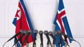 Flaggor av Nordkorea och Island på det internationella mötet eller konferensen framförande 3d Arkivfoton