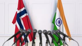 Flaggor av Norge och Indien på det internationella mötet eller konferensen framförande 3d Arkivbild