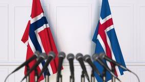 Flaggor av Norge och Island på det internationella mötet eller konferensen framförande 3d Arkivfoton