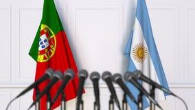 Flaggor av Portugal och Argentina på det internationella mötet eller konferensen framförande 3d Royaltyfri Foto