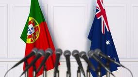 Flaggor av Portugal och Australien på det internationella mötet eller konferensen framförande 3d Royaltyfri Fotografi