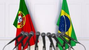 Flaggor av Portugal och Brasilien på det internationella mötet eller konferensen framförande 3d Arkivfoton