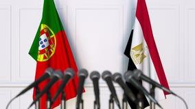 Flaggor av Portugal och Egypten på det internationella mötet eller konferensen framförande 3d Fotografering för Bildbyråer