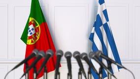 Flaggor av Portugal och Grekland på det internationella mötet eller konferensen framförande 3d Arkivbilder