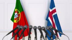 Flaggor av Portugal och Island på det internationella mötet eller konferensen framförande 3d Royaltyfri Fotografi