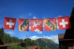 Flaggor av Schweiz Fotografering för Bildbyråer