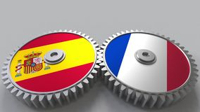 Flaggor av Spanien och Frankrike på att koppla ihop kugghjul Begreppsmässig tolkning 3D för internationellt samarbete stock illustrationer