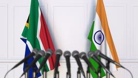 Flaggor av Sydafrika och Indien på det internationella mötet eller konferensen framförande 3d Royaltyfria Foton