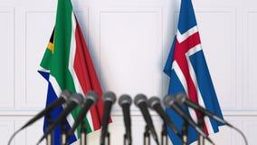 Flaggor av Sydafrika och Island på det internationella mötet eller konferensen framförande 3d Royaltyfri Fotografi