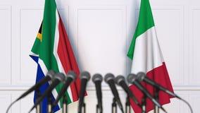 Flaggor av Sydafrika och Italien på det internationella mötet eller konferensen framförande 3d Arkivbild