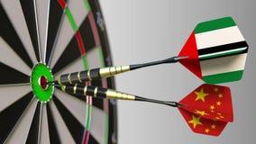 Flaggor av UAE och Kina på pilar som slår bullseyen av målet Begreppsmässiga internationellt samarbete eller konkurrens vektor illustrationer
