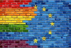 Flaggor för europeisk union och för bög för tegelstenvägg Arkivfoton