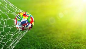Flaggor för fotbollboll i mål Royaltyfria Bilder
