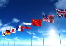 Flaggor för internationellt land under blå himmel Royaltyfria Foton