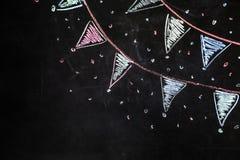 Flaggor för teckningskrita på den svarta bakgrunden Arkivfoto