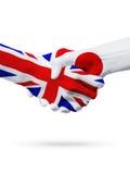 Flaggor Förenade kungariket, Japan länder, begrepp för partnerskapkamratskaphandskakning Fotografering för Bildbyråer