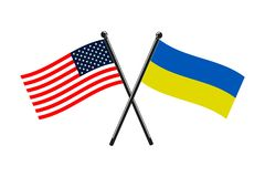 Flagi państowowe Ukraina i Usa krzyżowali na kijach royalty ilustracja