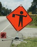 Flagman ahead caution. Warning sign, flagman ahead directing traffic Stock Photography