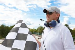 Flagman with checkered flag Stock Photo