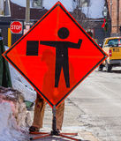 Flagman Road Work Sign Royalty Free Stock Photos