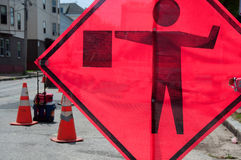 Flagman Sign at Construction Site. A hazard sign displaying a flagman icon warns of a neighborhood construction project stock photo