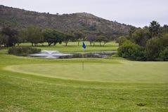 Flagpole, Green & Water Hazard royalty free stock photography