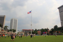 Flagpole at Merdeka Square. Kuala Lumpur, Malaysia - April 5, 2013: The 100 meter worlds tallest flagpole is located at Merdeka Square, where the Malayan flag royalty free stock photo