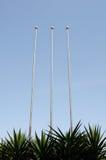 Flagpoles against sky Stock Photos