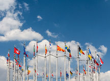 Flagpoles on the background of blue sky. Flags on the background of blue sky Royalty Free Stock Images