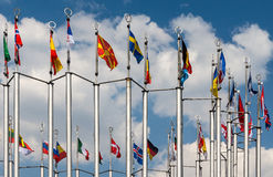 Flagpoles on the background of blue sky. Flags on the background of blue sky Stock Image