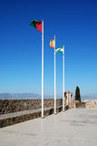 Flagpoles on Malaga castle. Royalty Free Stock Image