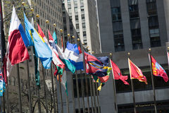 Flagpoles in NYC. Flagpoles display flags of United Nations member countries around the Rockefeller plaza. There are some 200 of them Royalty Free Stock Photo
