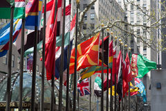 Flagpoles in NYC. Flagpoles display flags of United Nations member countries around the Rockefeller plaza. There are some 200 of them Stock Images