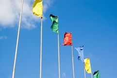Flags. Flutter on a wind against the sky stock image