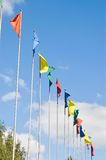 Flags. Flutter on a wind against the sky royalty free stock photo