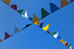 Flags. Many colored flags moved by the wind Royalty Free Stock Photo