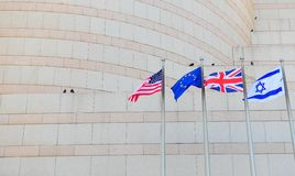 Flags. US, UK, EU and Israel in Front of the Granite Facade Stock Photography