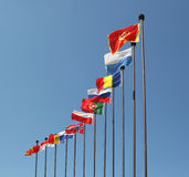 Flags. Of various countries fluttering in the wind stock image