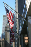 Flags. American flags hanging in front of a building Royalty Free Stock Photos