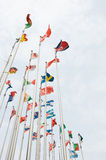 Flags. Of the world happily blowing in the wind royalty free stock images