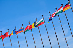 Flags. Of the different countries of the world against the sky Royalty Free Stock Photo