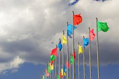 Flags. Many flags flaunt in cloudy sky Stock Photo