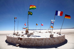 Flags. On the Salar de Uyuni, Bolivia Royalty Free Stock Photo