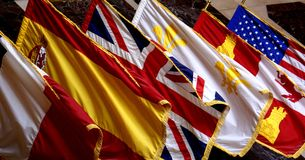 Flags. A variety of flags hanging inside the Louisiana State Capitol Building Stock Photos