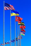 Flags against blue sky Stock Image
